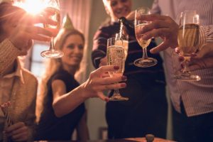 close up of group of friends pouring champagne on a party scaled 2 300x200 - 5 Tips for Finding a Last-minute Date for an Office Party